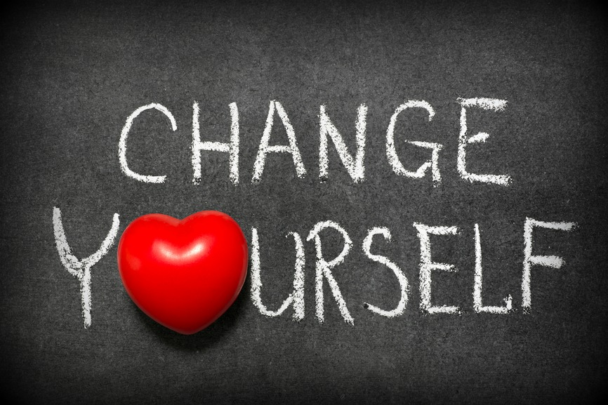 change yourself phrase handwritten on blackboard with heart symbol instead of O