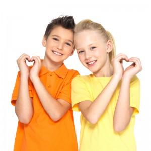 kids making heart hands